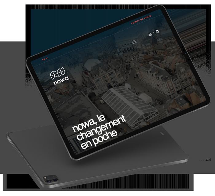 iPad noir avec le site e-commerce de nowa sur l'écran